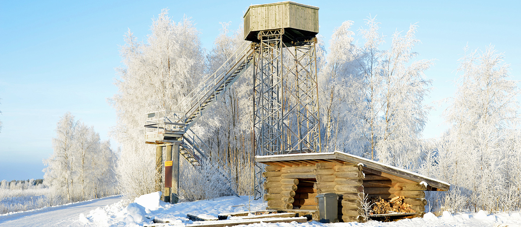 Bird watching tower and lean-to shelter in winter landscape